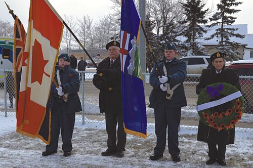 Pictured above, left-right, are Air Cadet Dylan Harris, Dave Champion, president of the McLennan branch of the Royal Canadian Legion, Sgt. Ashton Halldorson and wreath layer Wilbrod Girard. They participated in last year's service.