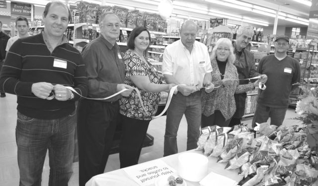 The Falher IGA held a grand re-opening and ribbon cutting ceremony for customers on Nov. 12, as the store is under new ownership and management. In the photo above, from left, are co-owner Gary Doran, co-owner John Nicolet, management member Bridgette Campbell, manager Nolan Parker, former owners Jean and Albert Lemire and management member Marc Maure.