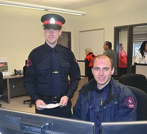 Constables Andre Gautreau, left, and Kraig Reid in the constable work bullpen.