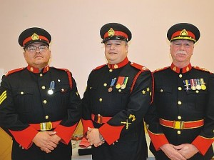 Long-service awards for 20 years from Alberta Solicitor General were presented to, left-right, Sgt. Dirk Tomkins and Sgt. Dean Seniak from Dale Cox, Chief of Police. Cox also received a medal as a Member of Merit of Police in Canada from the Governor General on Sept. 18