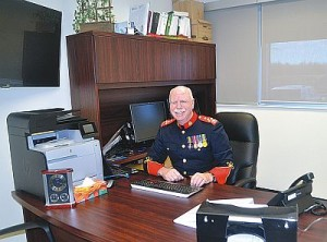 Chief of Police Dale Cox sits in his new large office.