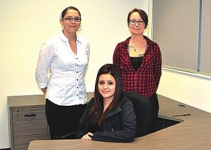 Lesser Slave Lake Indian Regional Council crime prevention co-ordinator Kristina Letendre sits in the programs room with restorative justice co-ordinator Nicole Bellerose, standing left, and victim services co-ordinator Shannah Asher.