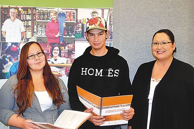 Driftpile entrepreneur workshop participants Nyanna Laboucan, left-right, and Carlton Giroux stand with Lesser Slave Lake Indian Regional Council employment counselor Mena Calahasen.