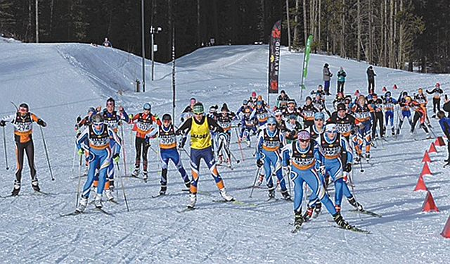 Pictured is the mass start for the 6-km. Juvenile Girls Skate Ski race, with Carlee Dick somewhere in the pack.