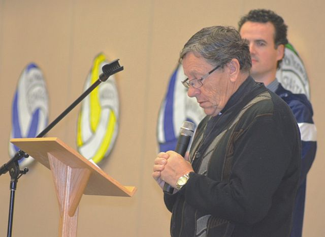 During the opening ceremony on Nov. 26, Deacon Reg Bouchard offers a prayer for the event.