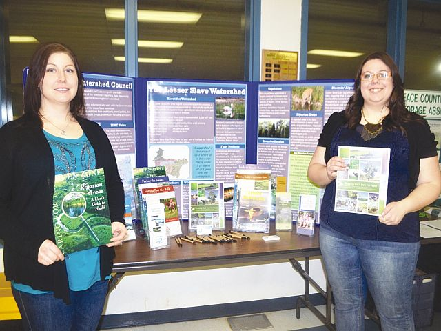 Lesser Slave Watershed Council executive director Meghan Payne, left-right, and watershed co-ordinator Kaylyn Jackson presenting resources.
