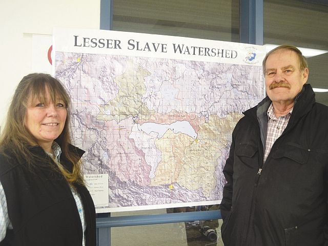 Lesser Slave Watershed chair Tammy Kaleta, left-right, and vice-chair Bob Popick stand by map of the watershed region.
