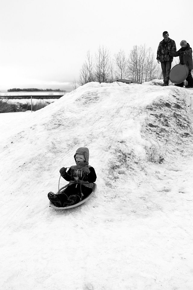 William McKay, 4, enjoys his run down the snow bank at Park Regalo.