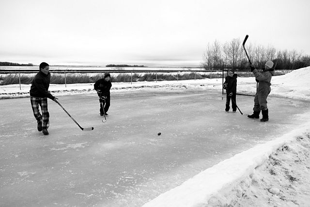 Derek Gravel created an outdoor rink at Park Regalo for Family Day. Utilizing the rink, left-right, are Adrien Maisonneuve, Nolan Yaremko, Keenan Labrecque and Dylan McIntosh.