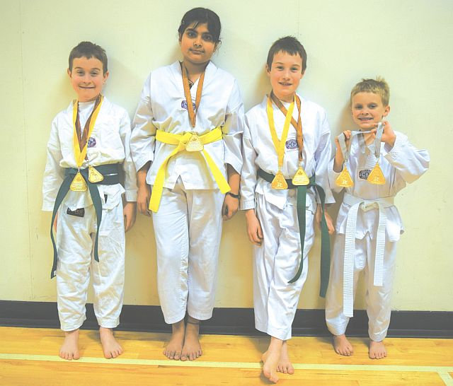 Pictured above are some of the medal winners of the Smoky River Road Warriors Taekwondo Club with the medals they won in Whitecourt. From left are Dylan Garant, Suzan Kocherla, Riley Garant and Reid Turnquist. They and six other athletes competed at the 26th Annual Whitecourt Taekwondo Championship, which was held at the Jean and Allen Millar Centre in Whitecourt on Jan. 30. Athletes can compete in both Forms and Sparring and here are some of the results. The 26th Annual Whitecourt Taekwondo Championship is sanctioned as an Alberta Black Belt team selection tournament. More information can be found at www.taekwondoalberta.com.