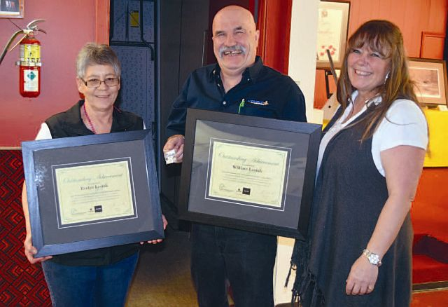 Above, from left are Evelyn Lesiuk, William Lesiuk the 20-year recipients, and presenter Tammy Kaleta.