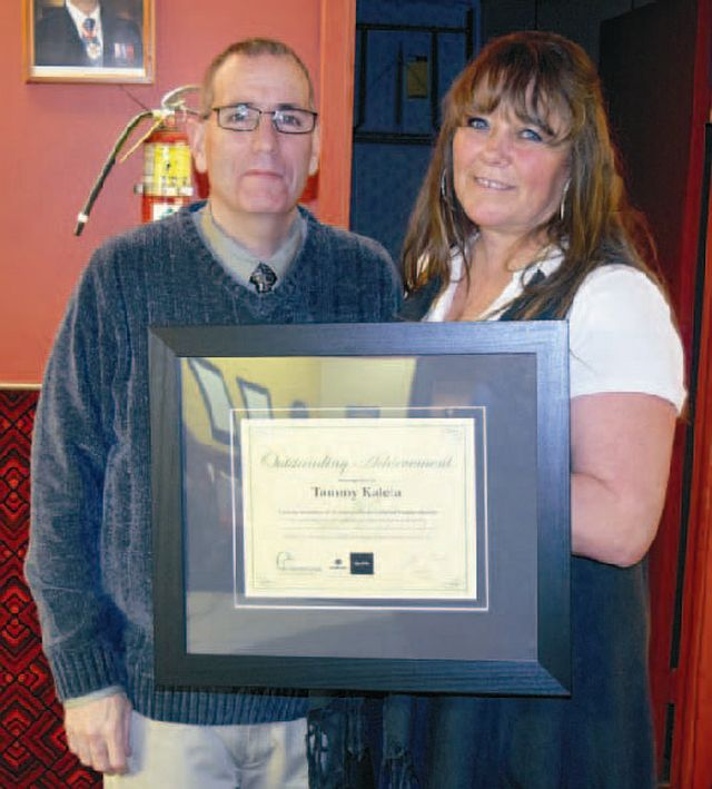 Tammy Kaleta, an organizer for the High Prairie chapter of Ducks Unlimited Canada, receives a 25-year service award from Dale Scott, the manager of Events and Volunteer Relations in Edmonton. This is the 23rd year for the High Prairie Ducks Unlimited banquet.