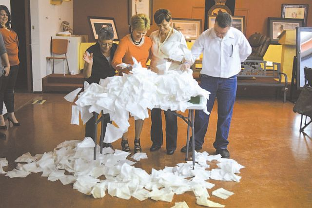 In a game of 'Minute to Win It', it was a race to be the first to empty the box of tissues . Left-right, are Evelyn Lesiuk (the winner and recipient of a barbecue), Judy Williscroft, Laverne Sander and Craig Matthews.