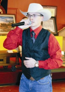 Chris Williscroft, the auctioneer for the live auction event.