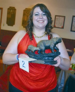 volunteer Kaylyn Jackson with one of the live auction items.