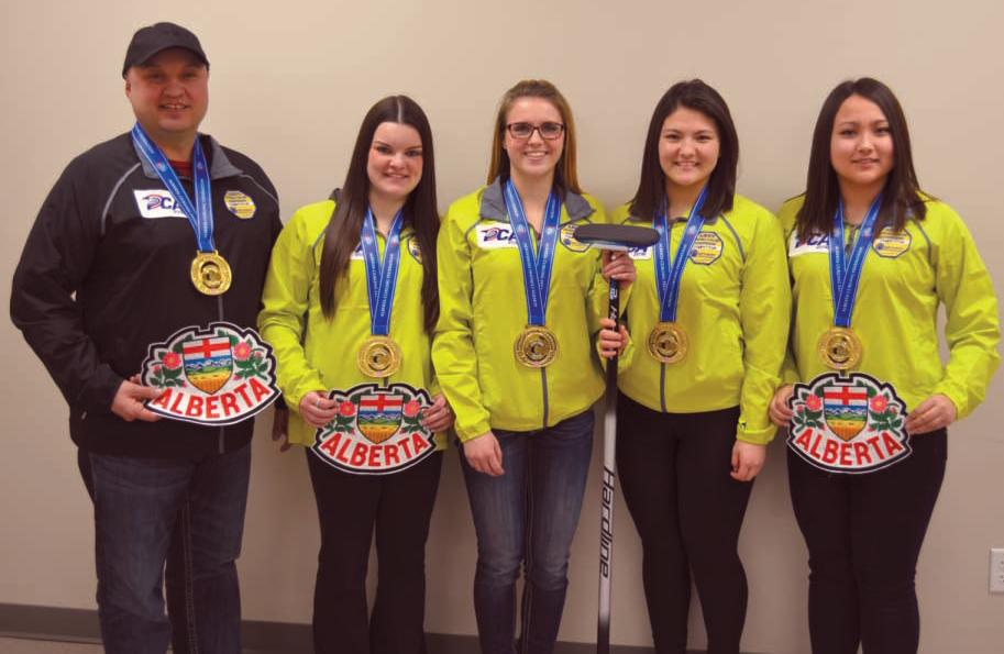 Left-right are coach Charles Simoneau, Meagan Aubin (lead) of Falher, Hailey Turcotte (second) of Falher, Ashton Skrlik (third) of Nampa, and Kayla Skrlik (skip) of Nampa, with their gold medal from the provincial championship.