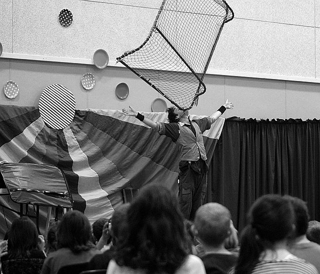 balancing a hockey net on his chin at an afternoon performance during La Foire de la famille (Family Fair) at École Héritage April 8.