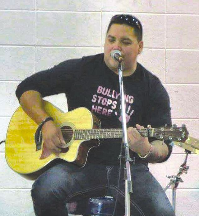 Cory Cardinal, of Kinuso, performing his original songs on his guitar.
