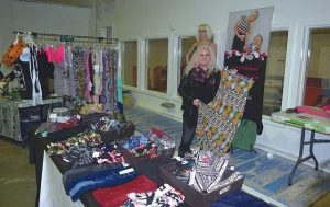 Dale Robertson, owner of Du North Designs by Dale in Guy, with her products in the home-based business and crafters show, in the curling rink.