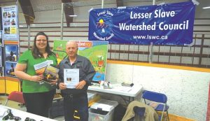 Kaylan Jackson, watershed coordinator, and Robert Nygaard, board member for the Lesser Slave Watershed Council. The curling rink was filled with merchants of all kinds for the home-based business and crafters show. There were also merchants out in the hall, between the Sports Palace and the Gordon Buchanan Recreation Centre.