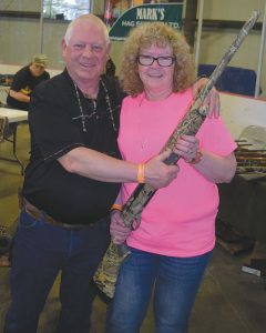 Pictured above are Bob Rohloff of the High Prairie Fish and Game Association, and Cathy Semeniuk of Eaglesham, winner of the Beretta A391 XTREMA Camo 12-gauge shotgun in the three-gun raffle.