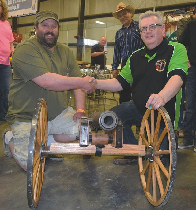 Pictured above, left-right, are Mark Marcinkow of Hilliard's Bay Estates, winner of the cannon, and Darrell Basarab, chairperson of the High Prairie Gun and Sportsman Show.