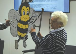 Bee hanging ornament shown to Falher council