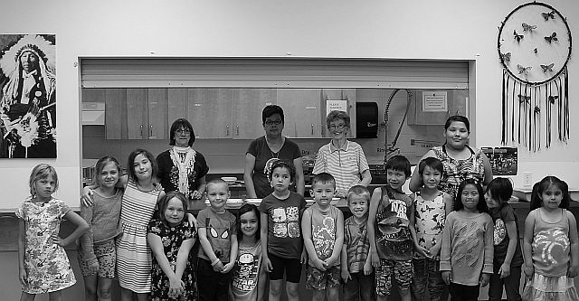 Members of Royal Purple with Ecole Providence students during the Royal Purple Day free hotdog lunch provided at the school on Friday June 3.