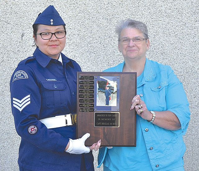 Sgt. Tanishia BigCharles, left, receives the Top Cadet Award from Lorene Rose, widow of the late Doug Rose, who was involved in the Air Cadet program for many years.