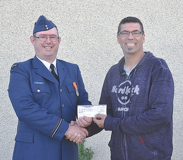 High Prairie Fish and Game Association president Leo Forseille, right, presents a $500 cheque to High Prairie Air Cadet Squadron Lieut. Dan Gillmor. The cadets volunteered their time at the Sportsmen's Show and in turn, the association makes a donation to the cadet program.