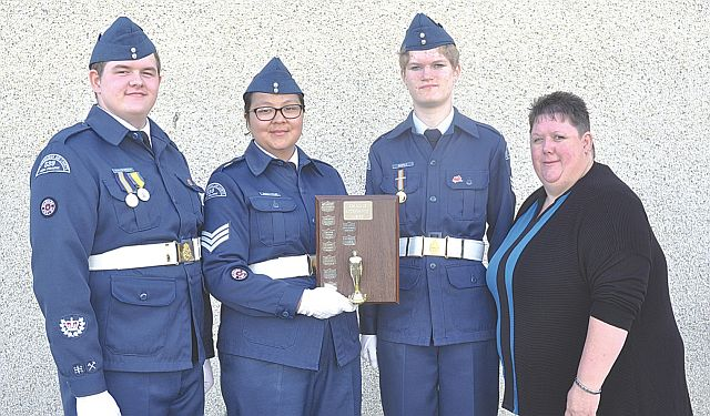 Three cadets received Best Attendance Awards at Annual Inspection. Each cadet did not miss a single parade all year. Left-right are W.O. II Ashton Halldorson, Sgt. Tanishia BigCharles, F/Sgt. Karen Waikle and Rosemary Halldorson, who presented the awards.