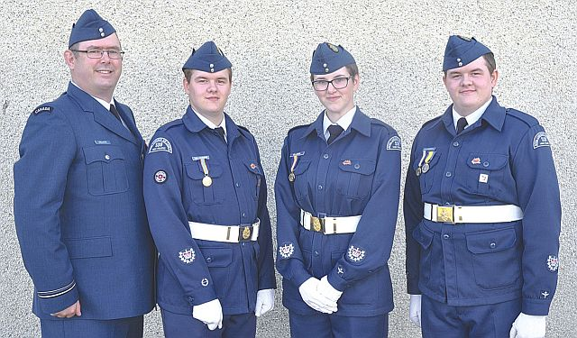 Three High Prairie Air Cadet members received promotions to W.O. II. Left-right are Lieut. Dan Gillmor, who presented the promotions, and Chad Halldorson, Kathleen Gillmor and Ashton Halldorson. Promotions are effective immediately.