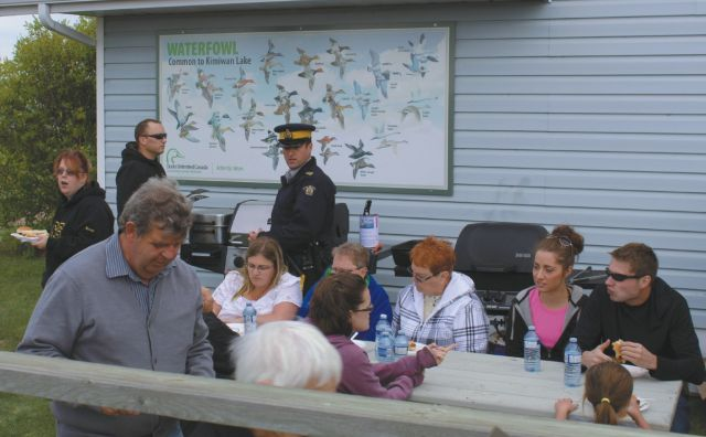 Local RCMP helping out at the 2015 Kimiwan Birdwalk Interpretive Centre end of season barbeque 2015