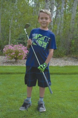 Brody Dumont, 9, won a sand wedge in a putting contest.