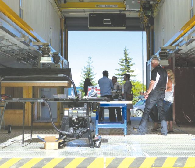 Visitors tour one of Northern Lakes College's mobile trades training labs at the August 12 event in Slave Lake celebrating the labs and the college's new crane and hoisting equipment.
