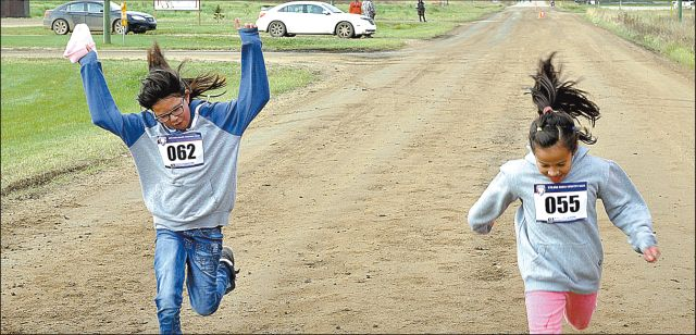 The first racers to cross the finish line were Trinity Calliou of Little Buffalo School, left, and Gabrielle Laboucan-Whitehead, also of Little Buffalo School.