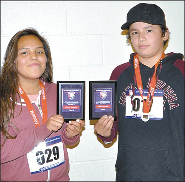Grade 8 winners included Peerless Lake School's Gina Alook in the girl's race, left, and Loon River School's Brian Auger in the boy's race.
