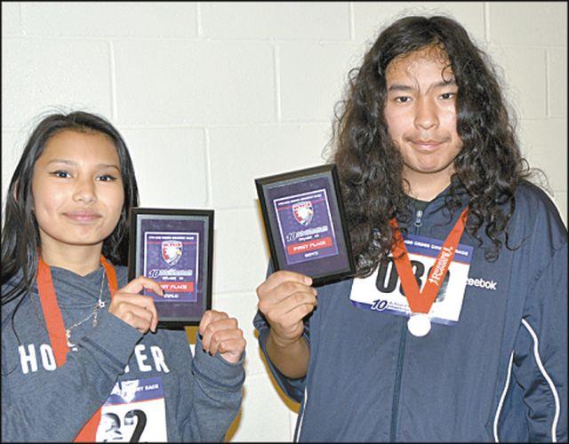 Grade 10 winners included Peerless Lake School's Jasmine Laboucan, left, in the girl's race, and Peerless Lake School's Denver Cardinal in the boy's race.