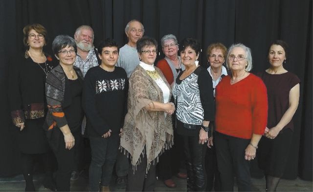 (back row left to right): Lilianne-Maisonneuve-Lavoie, Diane Therriault, Benoit Desrosiers, Normand Lagacé and Linda Doucet. (Front row left to right): Austin Doyle, President Carmen Ewing thanking Doris Doyle for the more than $11,000 raised at a Gala that she put on for the Society, in April of this year, Lucille Bussière, Corona Dionne and Wendy Gagnon. Photo taken by Elizabeth Bohnke.