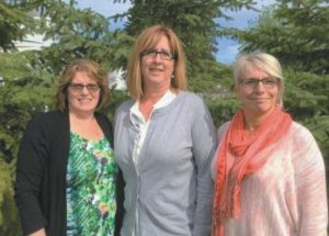 Three retired long-time McLennan Hospital staff members finally get together for group photograph