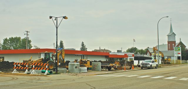 "Major paving and upgrading project in progress at ""Highway 2 Gas Bar"" parking lot in McLennan"