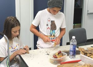 Kids try their hand in bark carving