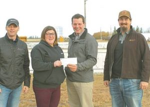 Girouxville Enhancement Committee receives $2,360 donation from Canterra Seeds for local rink upgrade
