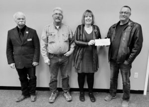 PICs – MLA makes cheque presentations to two organizations