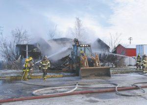 PICs – Fire destroys auto repair shop in Donnelly