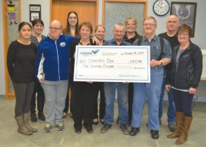Vision Credit Union presents a cheque for $1,000 to Grandma's Den