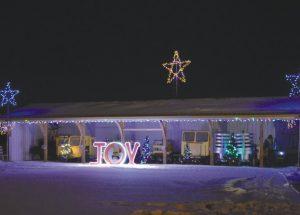 Joy to the World! McLennan holds Christmas light up