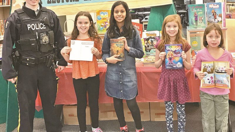 """RCMP staff donations provide free books to children at local schools through """"Red Coats Reading Program"""""""