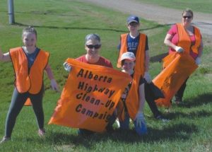 Volunteers clean up Highway 49 for fundraising