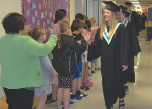 Congratulations! The GPV grads get high-fives from students at Ecole Routhier